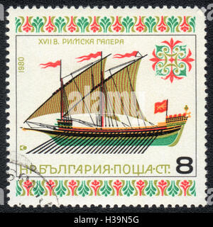 A postage stamp printed in Bulgaria shows Roman galley 17 century, circa 1980 - Stock Photo