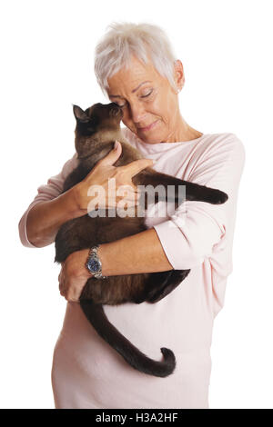 mature woman holding cat in her arms - Stock Photo
