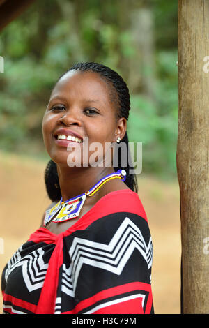 Swazi girl in traditional clothes strikes the pose at Mantenga Cultural Village,  Ezulwini Valley , Swaziland - Stock Photo