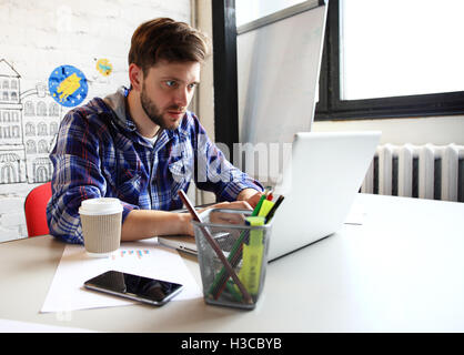 Photo young and talente finance manager working with new project. Handsome man working from his home office. Analyze - Stock Photo