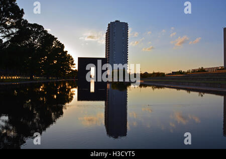The reflecting pool and 9:03 Gate at the Oklahoma City National Monument. - Stock Photo