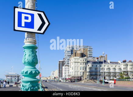 Parking sign pointing towards a car park on a main road in Brighton, East Sussex, England, UK. - Stock Photo