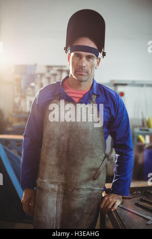 Portrait of male welder standing - Stock Photo
