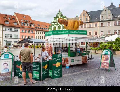 Stall selling original Thuringer Rostbratwurst in the Market Square (Markt), Weimar, Thuringia, Germany - Stock Photo