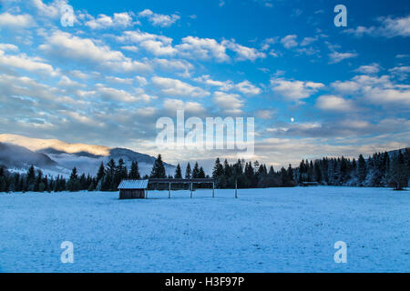 sunset after the first snowfall in the italian alps - Stock Photo