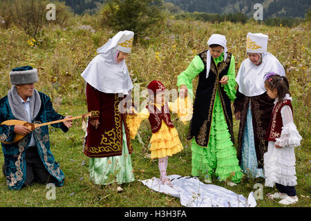 Steps after Tusau Kesu cutting the rope Kazakh traditional family ceremony blessing of young child - Stock Photo
