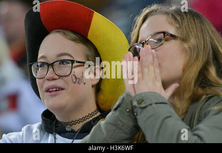 Hamburg, Germany. 08th Oct, 2016. Supporters of the German national soccer team cheer for their team prior to the - Stock Photo