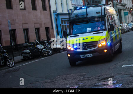 London Metropolitan Police Van Responding to an Emergency with Blue lights flashing - Stock Photo