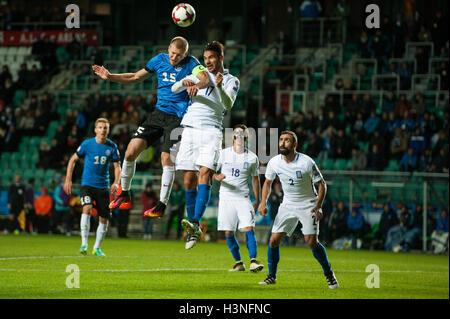 Tallinn, Estonia, 10th October 2016. Ragnar Klavan (L) of Estonia fights for the ball with Vasilis Torosidis (R) - Stock Photo