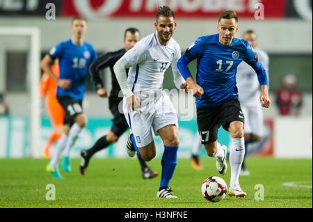 Tallinn, Estonia, 10th October 2016. Panagiotis Tachtsidis (L) of Greece fights for the ball with Siim Luts  (R) - Stock Photo
