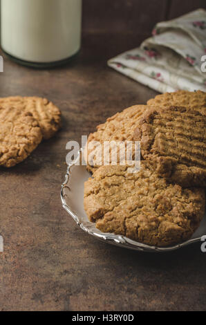 Cookies with peanut butter wholegrain, delicious with milk - Stock Photo