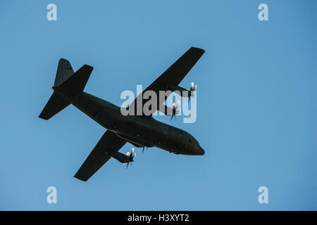 A Lockheed Martin C-130J Super Hercules in flight - Stock Photo