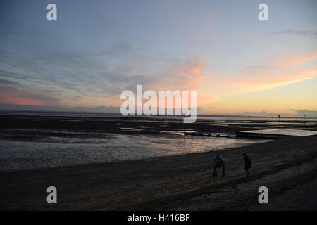 Southend-on-Sea beach at sunset, Essex - Stock Photo