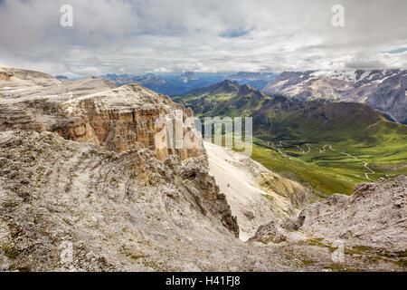 Pordoi pass mountain road valley and Piz Boe seen from the Sass Pordoi plateau in Dolomites, Italy, Europe - Stock Photo