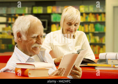 Senior couple, library, sit, read books, page through, bookstore, public library, living-room furniture, reading - Stock Photo