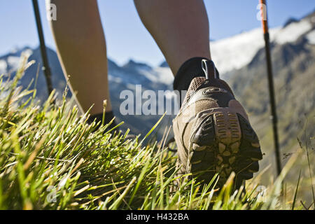 Austria, Tyrol, Oetztal Alps, Obergurgl, Close-up of woman hiking in mountains - Stock Photo