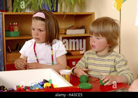 Girls, boy, kindergarten, do handicraft, knead, half portrait, - Stock Photo