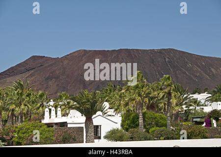 Spain, Canary islands, Lanzarote, Playa Blanca, dwelling houses, volcano mountain, - Stock Photo