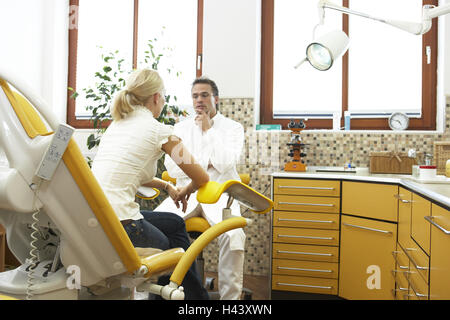 Medical practise, gynecologist, woman, consultation, eye contact, examination chair, sit, model released, - Stock Photo