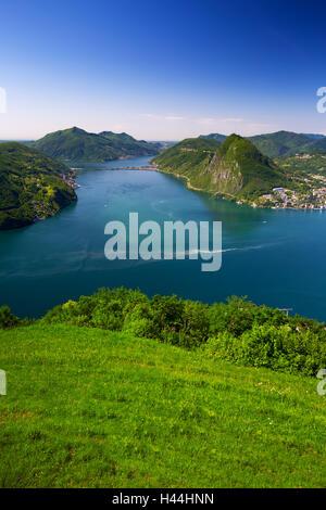 View to Lugano city, Lugano lake and Monte San Salvatore from Monte Bre, Ticino, Switzerland - Stock Photo