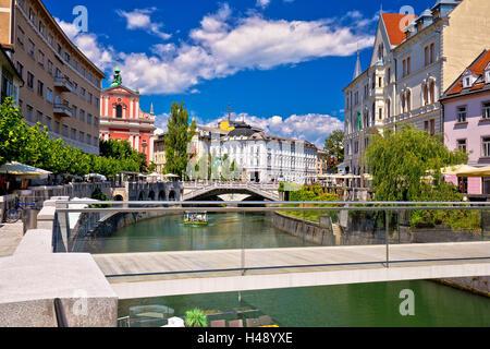 Ljubljana city center on green river Ljubljanica, capital of Slovenia - Stock Photo