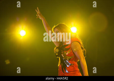 German hit singer Andrea Berg stands on stage during her concert 'Seelenleben' (lit. 'soul life') in Krefeld, Germany, - Stock Photo