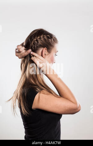 Instruction:  braided plaits, two 'Gretchen' braids, Step 2 from 3 - Stock Photo