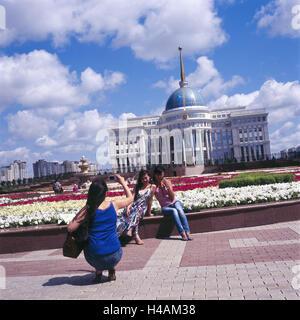 Kazakhstan, Astana, Ak Orda presidential palace, tourist, structure, building, place of interest, person, women, - Stock Photo