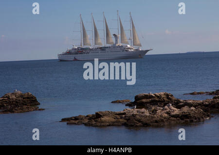 Wind Surf, seen here sailing into the port of Gudhjem on the Danish Island of Bornholm, features a very shallow - Stock Photo