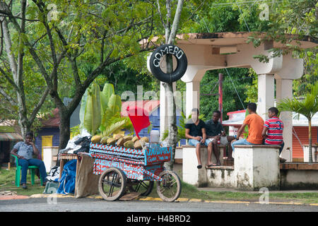 The Dominican Republic, the east, coconut seller in the crossroads 103 / 104 to the north of Otra Banda - Stock Photo