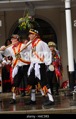 Folk dancers dancing during an annual  folk festival in Tenterden, Kent, England - Stock Photo