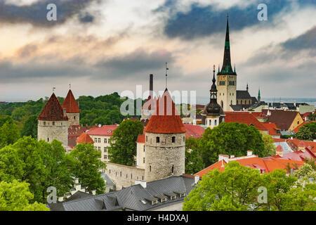 View over Tallinn to the city wall and the St. Olavs Church (Oleviste kirik), Tallinn, Estonia, Baltic States, Europe - Stock Photo