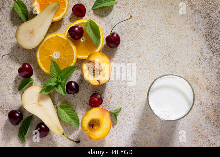 Assortment of fruits and berries for making milkshakes on the stone background. Fresh organic ingredients. Desirable - Stock Photo