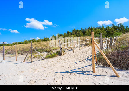 Entrance to beautiful sandy beach in Lubiatowo coastal village, Baltic Sea, Poland - Stock Photo