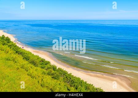 A view of sandy beach from cliff in Jastrzebia Gora coastal village, Baltic Sea, Poland - Stock Photo