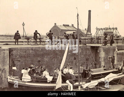 Onlookers view the locking of the Hollandia boat Oranjesluizen Amsterdam, The Netherlands, Anonymous, c. 1900 - - Stock Photo