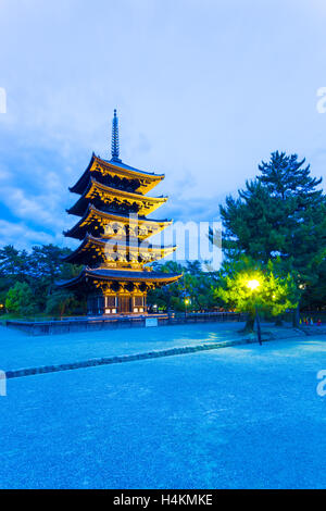 Dramatic blue sky and lighted five story pagoda, goju-no-to, at evening blue hour in Kofuku-ji temple complex in - Stock Photo