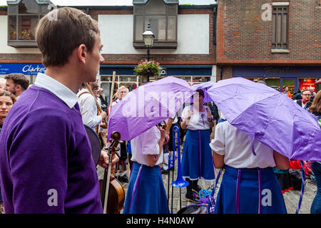 Female Morris Dancers Stand Underneath Umbrellas During A Rain Shower, Lewes Folk Festival 2016, Lewes, Sussex, - Stock Photo