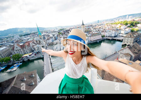 Woman traveling in Zurich city - Stock Photo
