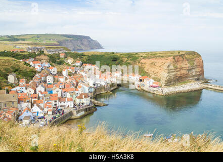View over picturesque Staithes village looking north from Penny nab on the Cleveland Way footpath. North Yorkshire, - Stock Photo