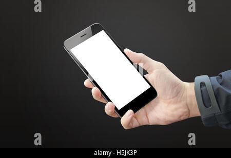 Black smart phone in man hand. Blank screen of mobile device for mockup. Dark black background. - Stock Photo