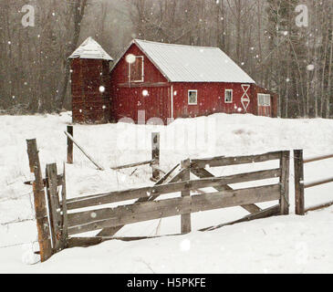 Old red barn in beautiful snowy winter landscape, Twisp, Methow Valley, Washington State, WA - Stock Photo