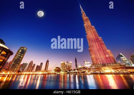DUBAI, UAE - FEBRUARY 17: Burj Khalifa and fountain - world's tallest tower at 828m at night with moon light - Stock Photo