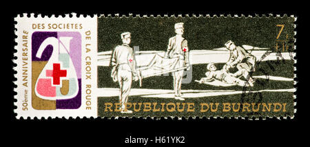 Postage stamp from Burundi depicting stretcher bearers with a wounded man. - Stock Photo