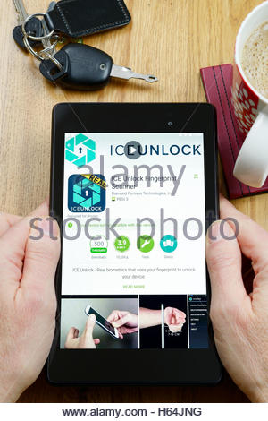 ICE Unlock Fingerprint Scanner app shown on a tablet computer, Dorset, England, UK - Stock Photo