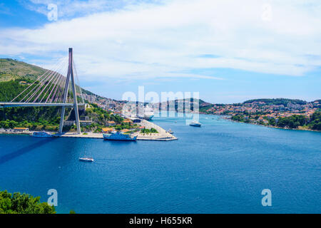 DUBROVNIK, CROATIA - JUNE 26, 2015: Scene of the Franjo Tudman Bridge, and the port of Gruz, with ferry boat, passenger - Stock Photo