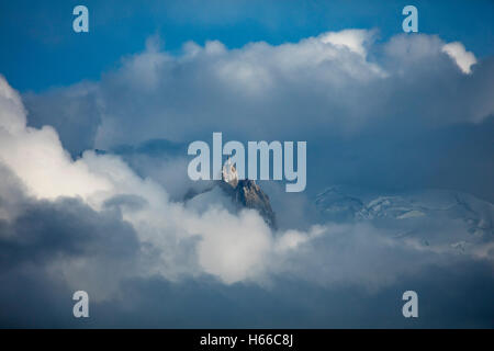 The Aiguille du Midi pokes above the cloud, Chamonix Valley, French Alps, France. - Stock Photo