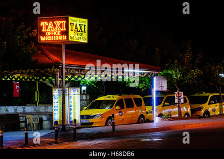 Taxi rank office at night in Hisaronu, Oludeniz, Fethiye, Turkey. - Stock Photo
