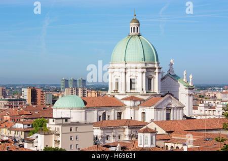 Brescia - The Duomo cupola over the town in morning light. - Stock Photo