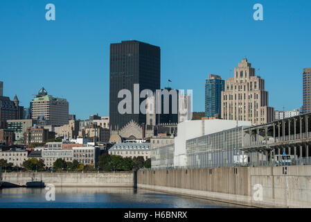 Canada, Quebec, Montreal. Old Port area city skyline view from St. Lawrence River. New cruise pier with Notre-Dame - Stock Photo